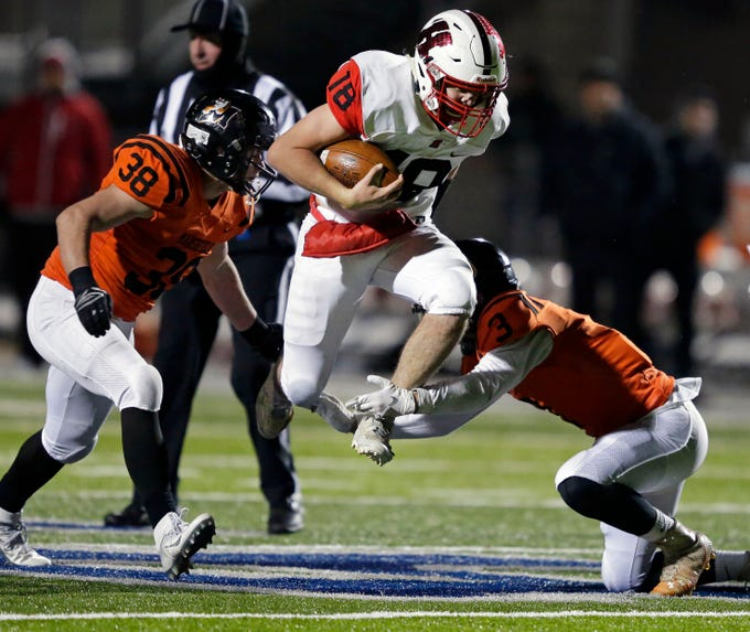 Emory Weeden of Homestead carries the ball as Ben Gust (38) and Nolan Hertel (3) of Marshfield close for a stop in a WIAA Division 2 state semifinal football game Friday, November 9, 2018, at Calder Stadium in Menasha, Wis.Ron Page/USA TODAY NETWORK-Wisconsin