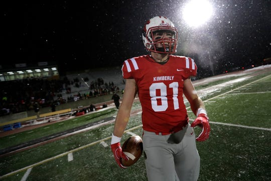 Kimberly's Mitch Bartol (81) is all smiles after successfully scoring on a two-point conversion pass in overtime to defeat Fond du Lac during a WIAA Division 1 state semifinal football game last November.