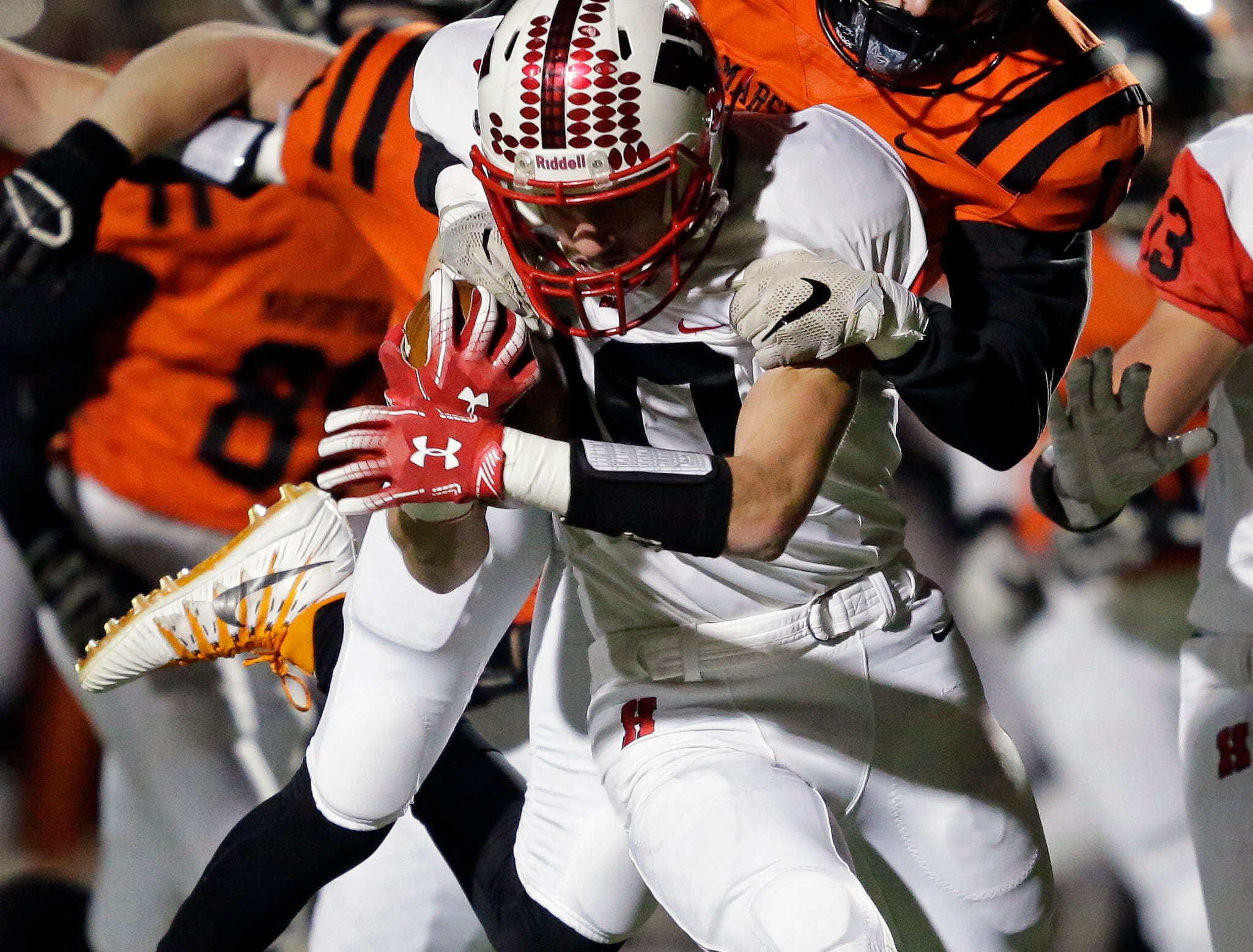 Jared Schneider of Homestead is tackled by Joey Goettl of Marshfield in a WIAA Division 2 state semifinal football game Friday, November 9, 2018, at Calder Stadium in Menasha, Wis.Ron Page/USA TODAY NETWORK-Wisconsin
