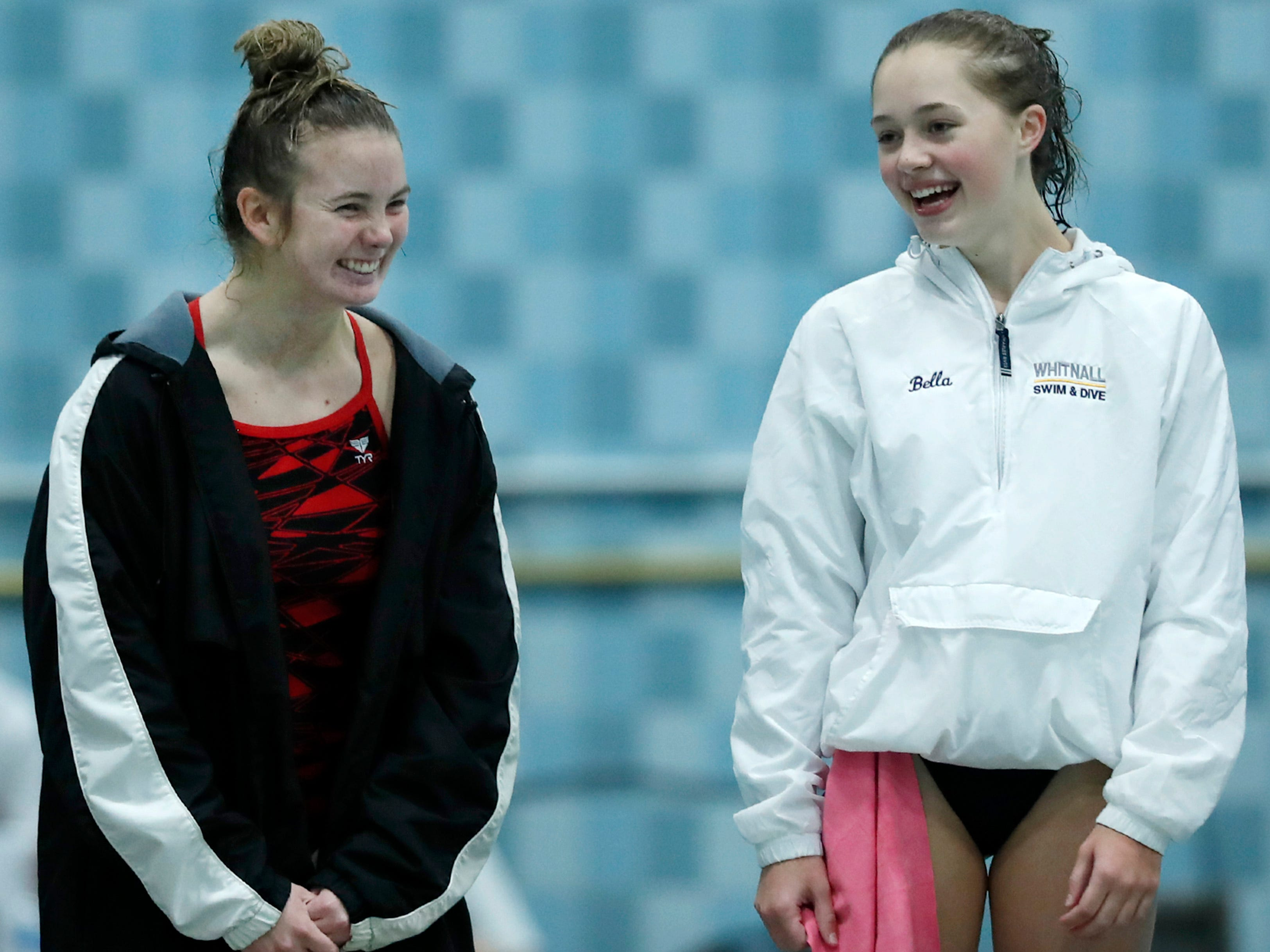 Seymour's Erin Schuh (left) laughs with Whitnall's Bella Smith after Schuh took third place in diving during WIAA Division 2 State Swimming and Diving Friday, Nov. 9, 2018, at the UW Natatorium in Madison, Wis.