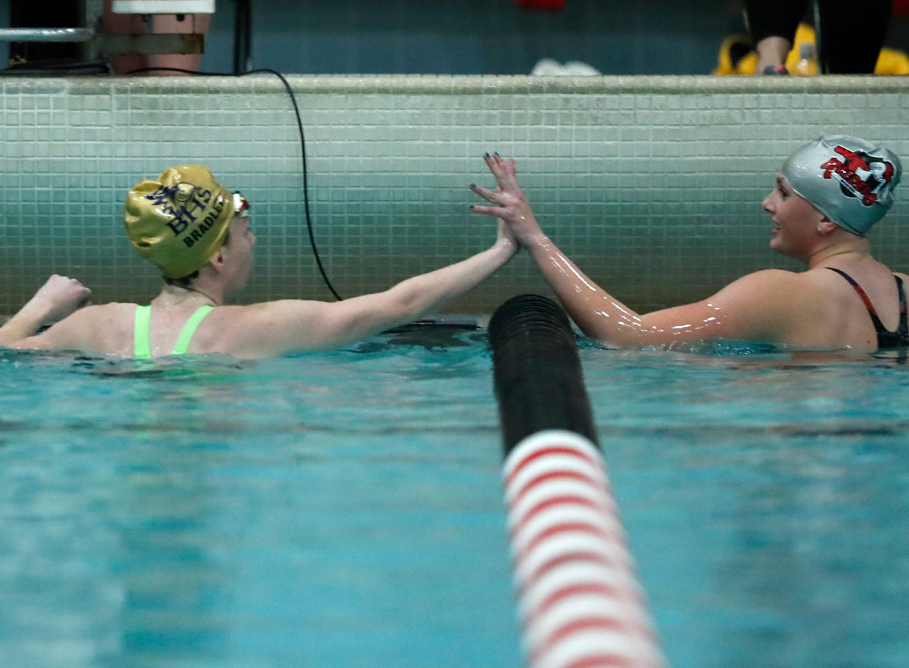 Baraboo's Taylor Bradley high fives Medford's Aubrey Buskerud after finishing the 200 yard individual medley during the WIAA Division 2 State Swimming and Diving meet Friday, Nov. 9, 2018, at the UW Natatorium in Madison, Wis.Danny Damiani/USA TODAY NETWORK-Wisconsin