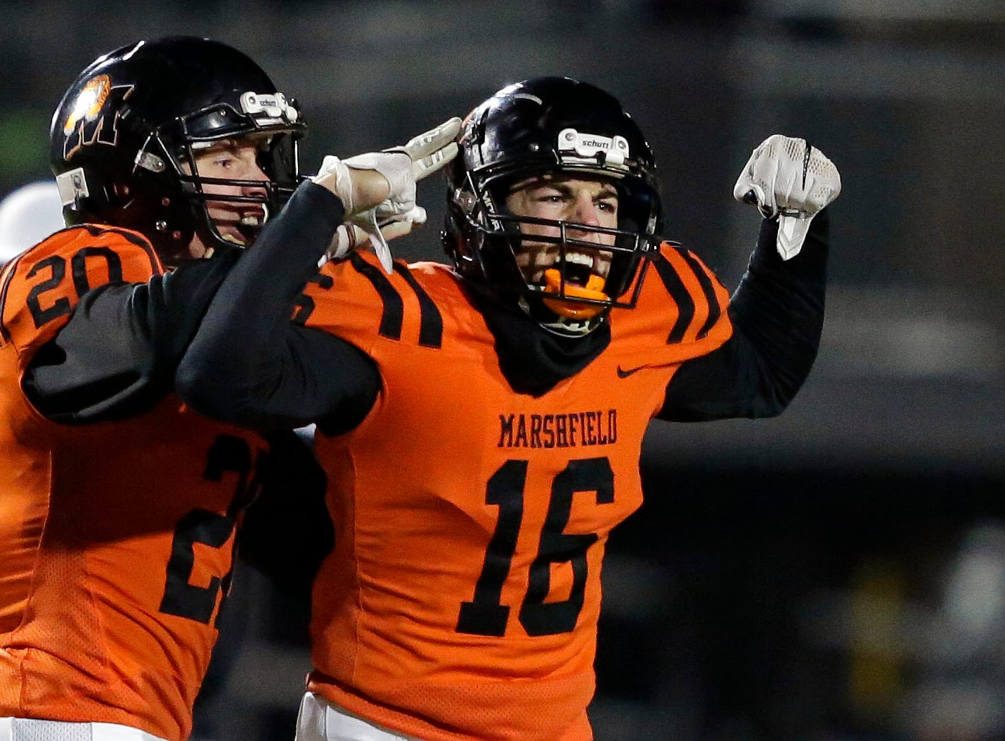 Bently Schwanebeck-Ostermann of Marshfield celebrates a stop against Homestead that resulted in a turnover on downs during a WIAA Division 2 state semifinal football game Friday, November 9, 2018, at Calder Stadium in Menasha, Wis.Ron Page/USA TODAY NETWORK-Wisconsin
