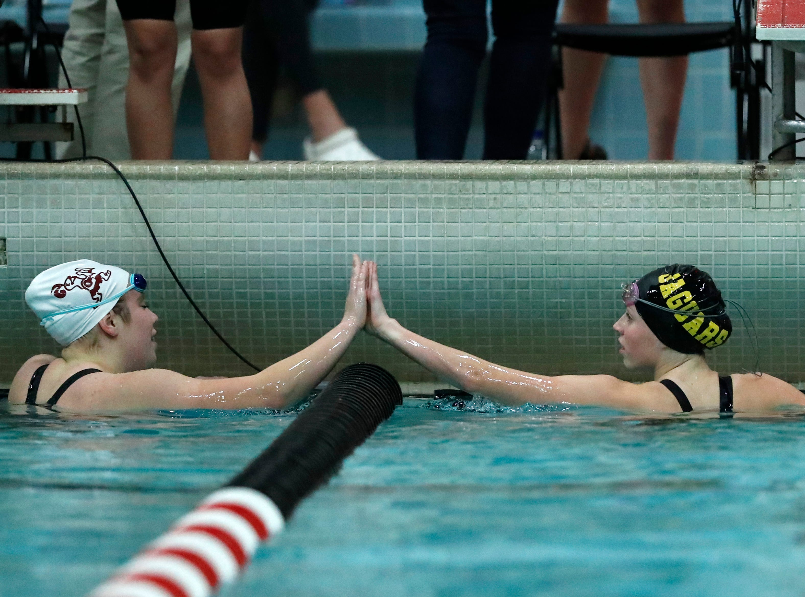 Edgewood's Mallory Todd high fives Ashwaubenon's Hallory Domnick after finishing the 100 yard butterfly during the WIAA Division 2 State Swimming and Diving meet Friday, Nov. 9, 2018, at the UW Natatorium in Madison, Wis.Danny Damiani/USA TODAY NETWORK-Wisconsin