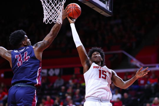 Rutgers' Myles Johnson goes up for a shot with Fairleigh Dickinson's Mike Holloway Jr. defending