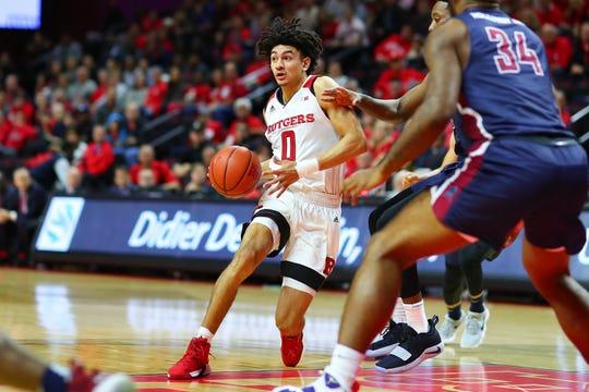 Geo Baker dribbles for Rutgers vs. FDU