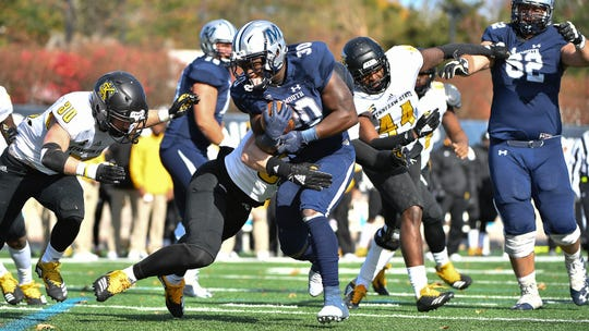 Monmouth's Juwon Farri picks up yardage against Kennesaw State on Saturday at Kessler Stadium in West Long Branch.