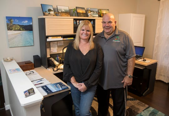 Joe and Sue Leo, owners of JBL Travel Group, shown in their home office.