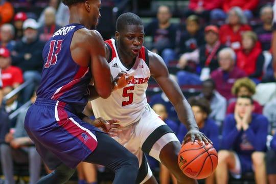 Rutgers' Eugene Omoruyi drives against FDU
