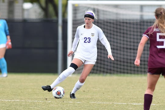 Hardin-Simmons defender Baylee Ford (23) makes a pass during the NCAA tournament's first round against Puget Sound on Saturday at HSU's soccer field.