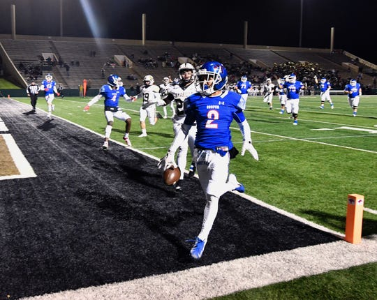 Cooper's Daelin Campos gets into the end zone for a first-half touchdown in the regular season finale against Amarillo High last season at Shotwell Stadium. Amarillo High won the District 2-5A Division I game 58-27.