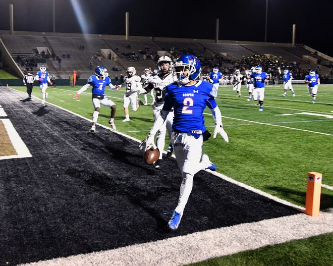 Cooper's Daelin Campos gets into the end zone for a first-half touchdown for the Cougars in their regular season finale against Amarillo High at Shotwell Stadium.