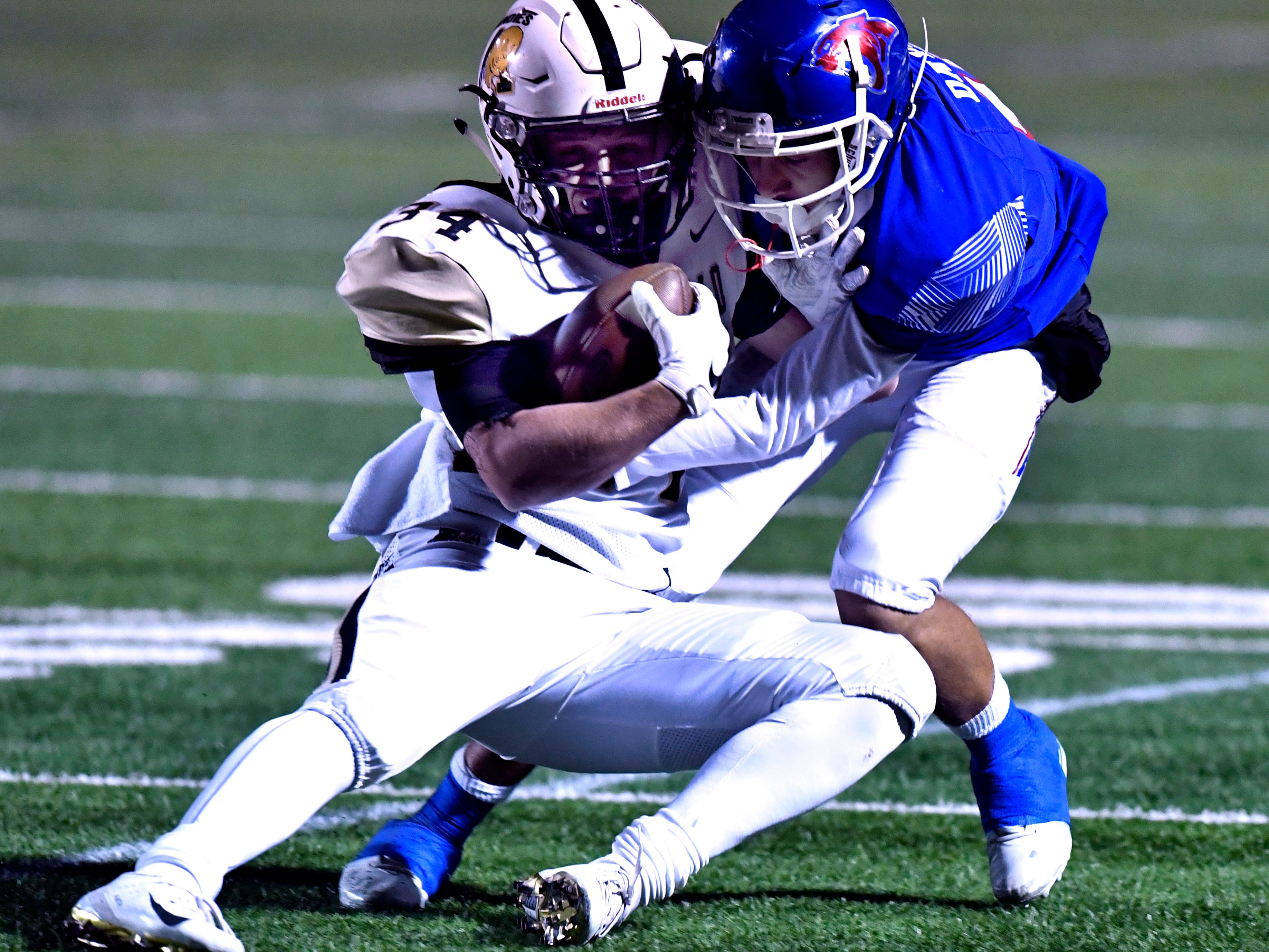 Cooper High defensive back Dylon Davis tackles Amarillo High running back Blake Bedwell during Friday's game at Shotwell Nov. 9, 2018. Final score was 58-27, Amarillo.
