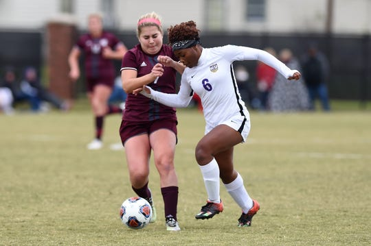 Hardin-Simmons forward Finda Kollie (6) battles Puget Sound's Elizabeth McGraw (7) for the ball during the NCAA tournament's first round Saturday. The Cowgirls scored three times in the second half to advance to the second round.