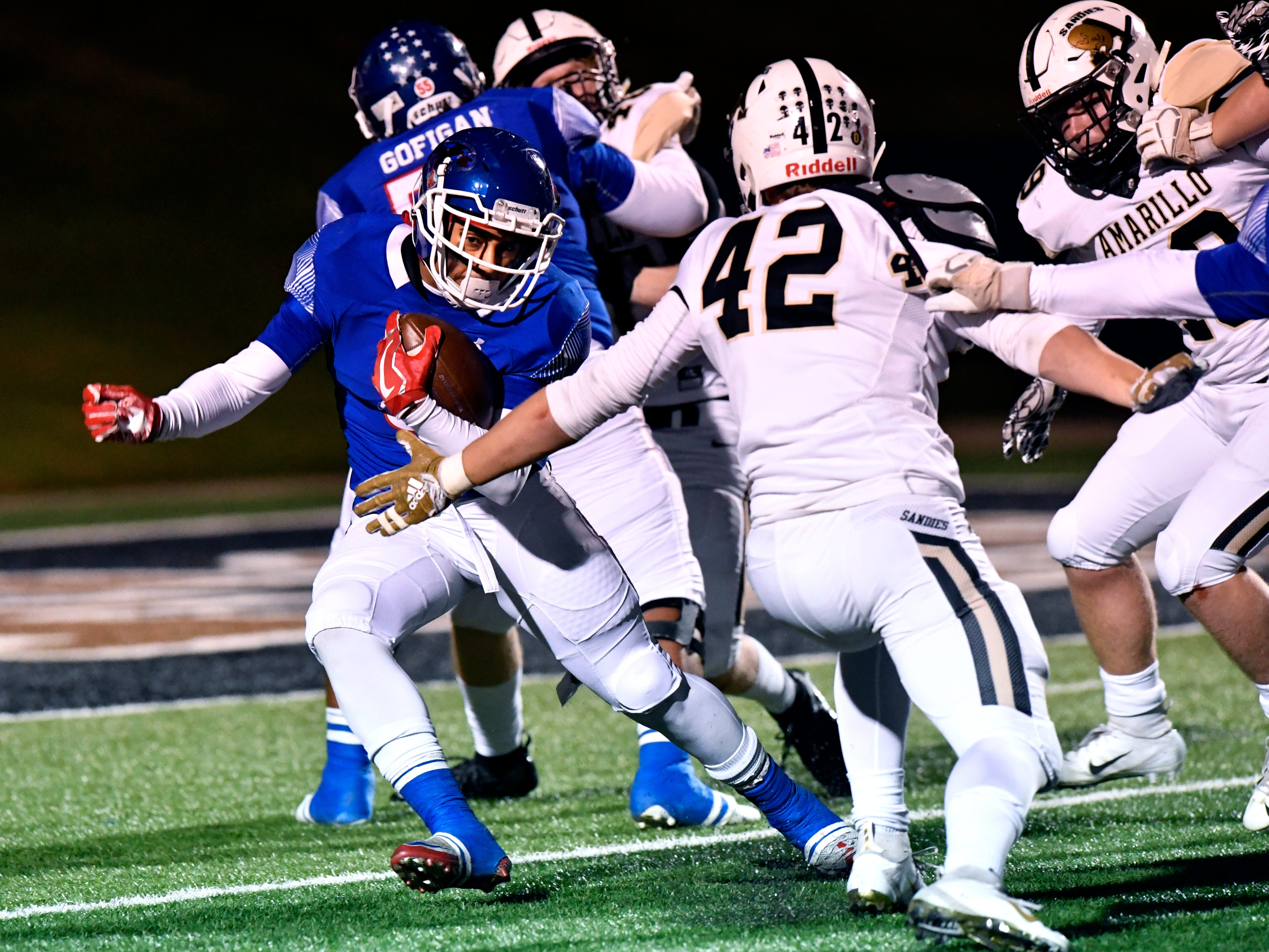 Cooper High running back Noah Garcia sprints past the outstretched arm of Sandies defensive lineman Bret Gilbert during the Cougars game against Amarillo High Friday Nov. 9, 2018. Final score was 58-27, Amarillo.