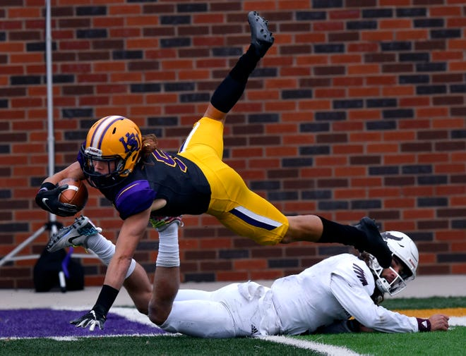 Hardin-Simmons wide receiver Reese Childress dives after being tackled by McMurry's Kevin Hurley Jr. (3) during Saturday's crosstown game at HSU. Childress caught 11 passes for 130 yards and a touchdown in HSU's 83-6 win.