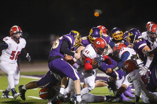 The Wylie defense piles in to stop Plainview tailback Andrew Villa as he pushes toward the goal line. Villa rushed for 95 yards for Plainview, which won 22-19 at Bulldog Stadium.