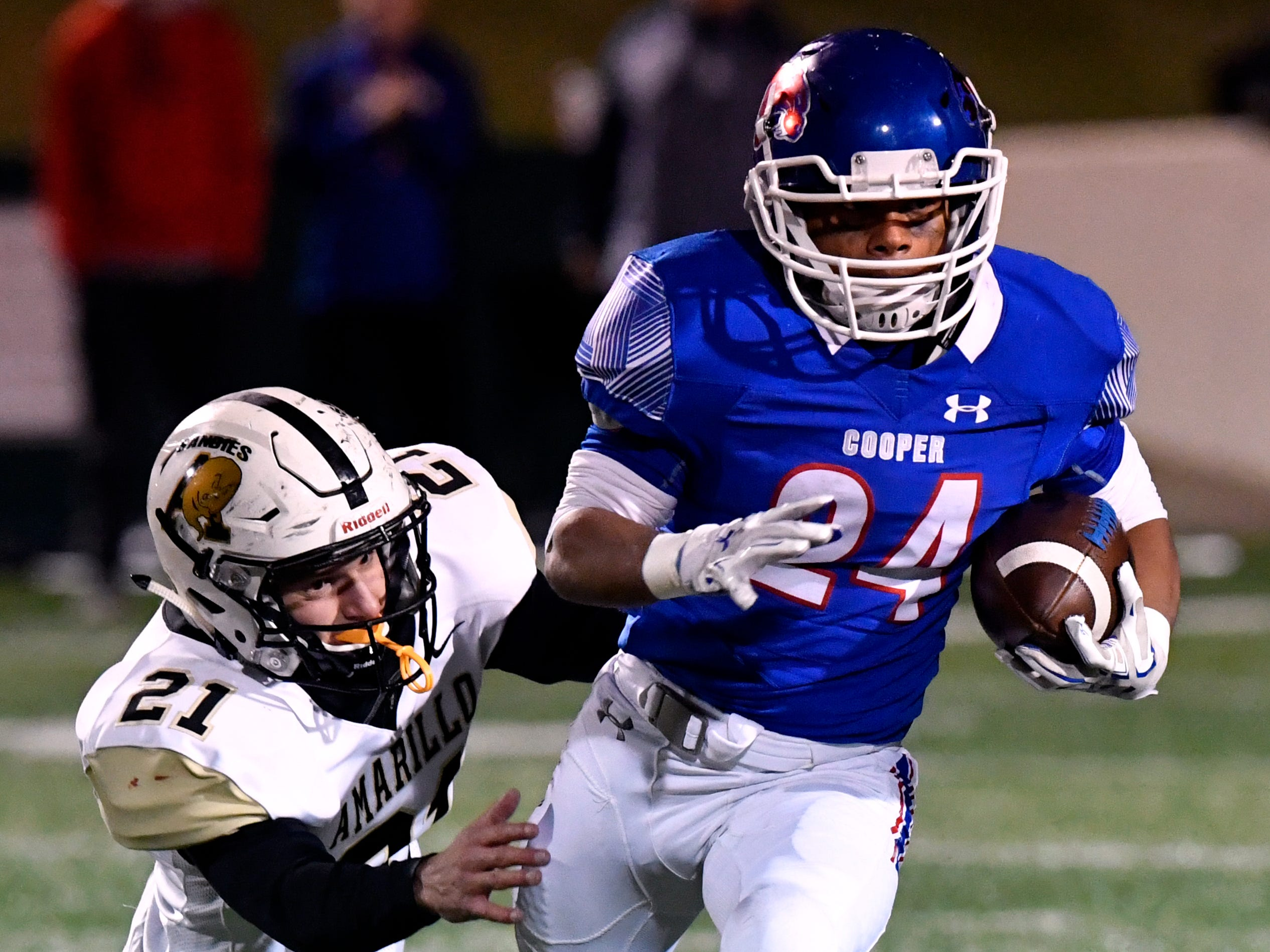Cooper High running back Jessus Menjivar outruns Sandies linebacker Nelson Sutterfield during Friday's game Nov. 9, 2018. Final score was 58-27, Amarillo.