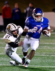 Cooper running back Jessus Menjivar outruns Sandies linebacker Nelson Sutterfield. The junior ran for 51 yards on eight carries in the Coogs' 58-27 loss to the Sandies on Friday, Nov. 9, 2018, at Shotwell Stadium. The loss dropped Cooper from the district's No. 2 seed to the fourth and final seed for the playoffs.