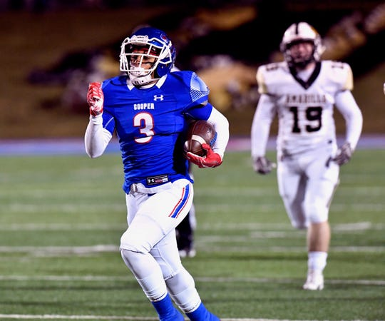 Cooper running back Noah Garcia breaks for a long first touchdown early in Friday's game against Amarillo High at Shotwell Stadium. The Cougars built a quick 20-0 lead but were down 31-27 at halftime.
