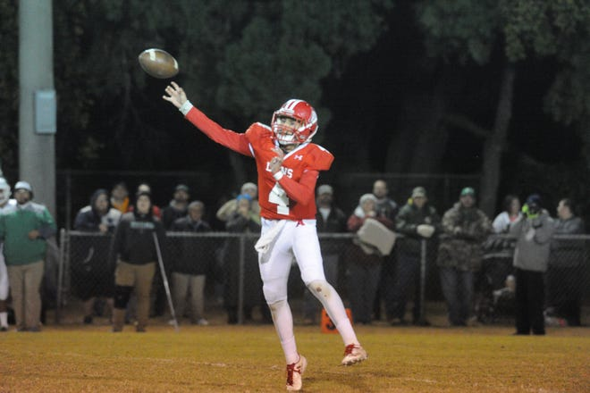 Albany quarterback Ben West launches a pass downfield in the first quarter of the Lions' game against Hamlin on Friday at Robert Nail Memorial Stadium. Albany won 34-27 to earn the District 7-2A Division II championship.