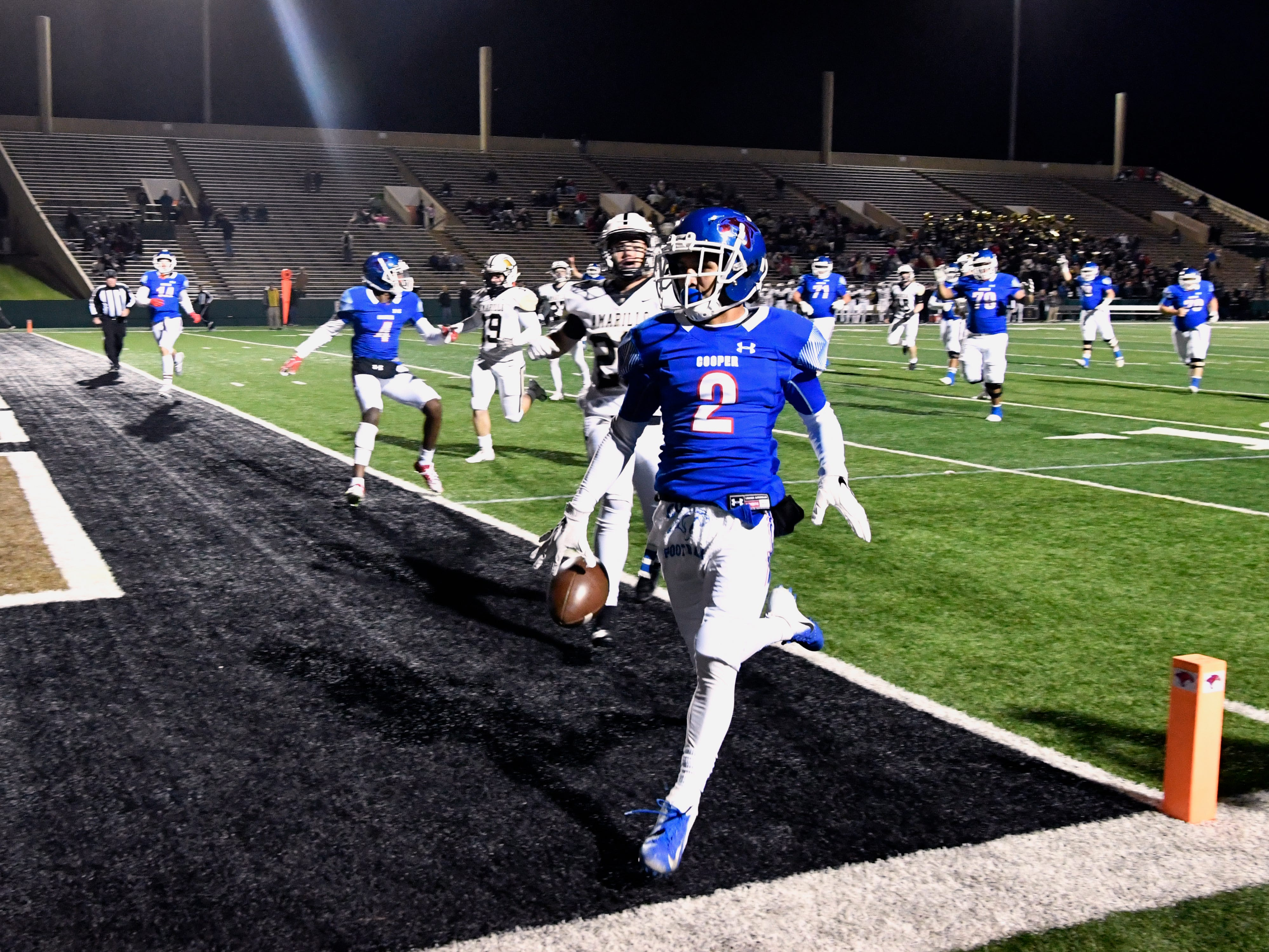 Cooper High School wide receiver Daelin Campos runs the ball in for a touchdown against Amarillo during the first few minutes of Friday's game Nov. 9, 2018.