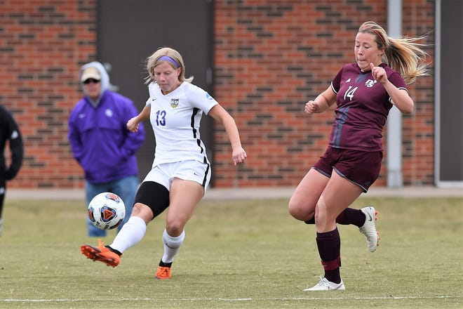 Hardin-Simmons midfielder Josey Meyer (13) sends a cross into the box ahead of a Puget Sound defender during the NCAA first round match at the HSU Soccer Complex on Saturday. The Cowgirls advanced to Sunday's second-round game with a 3-0 victory.