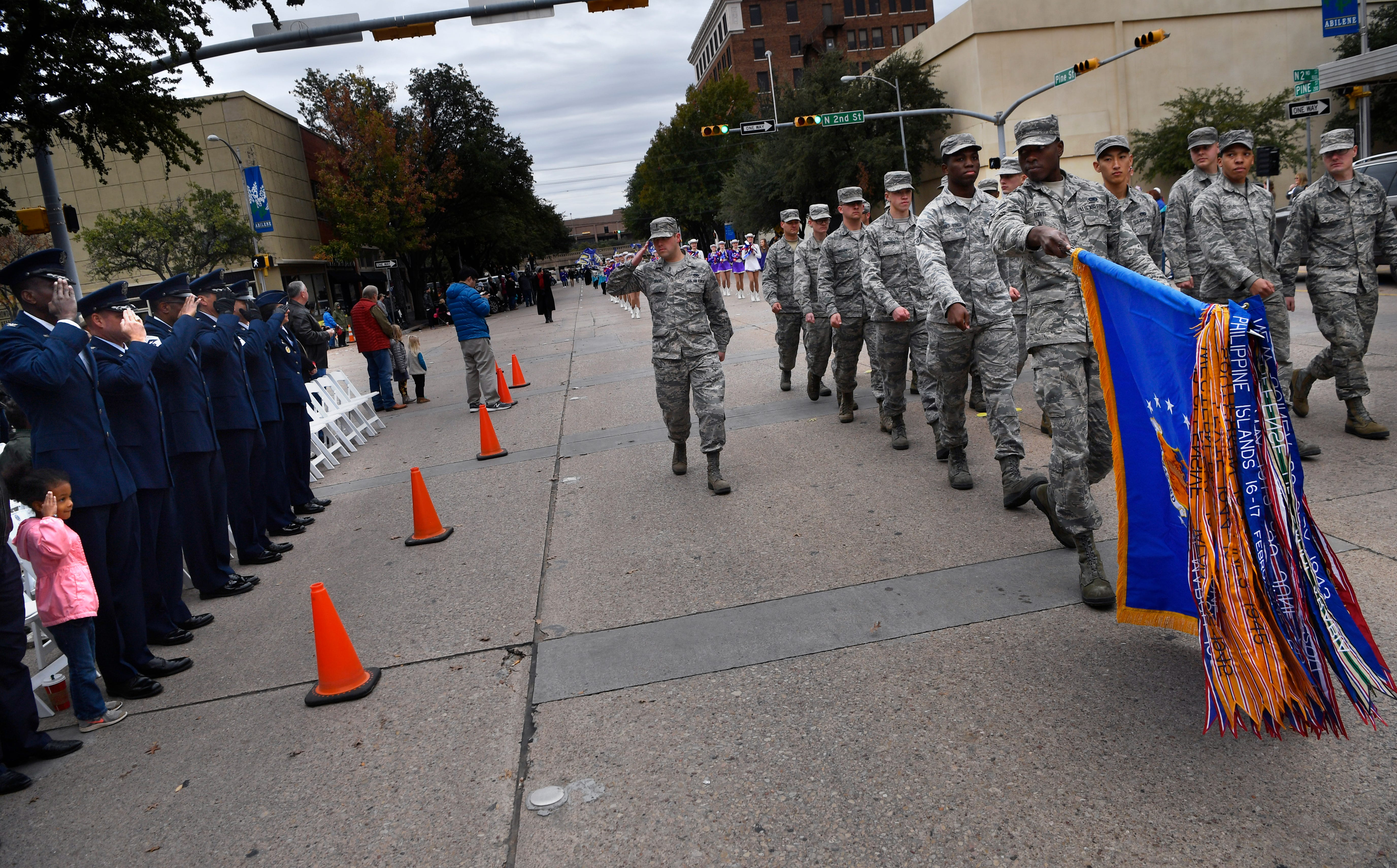 U.S. Air Force members salute senior officers from Dyess Air Force Base and the parade stand during Saturday's Veterans Day parade in downtown Abilene.