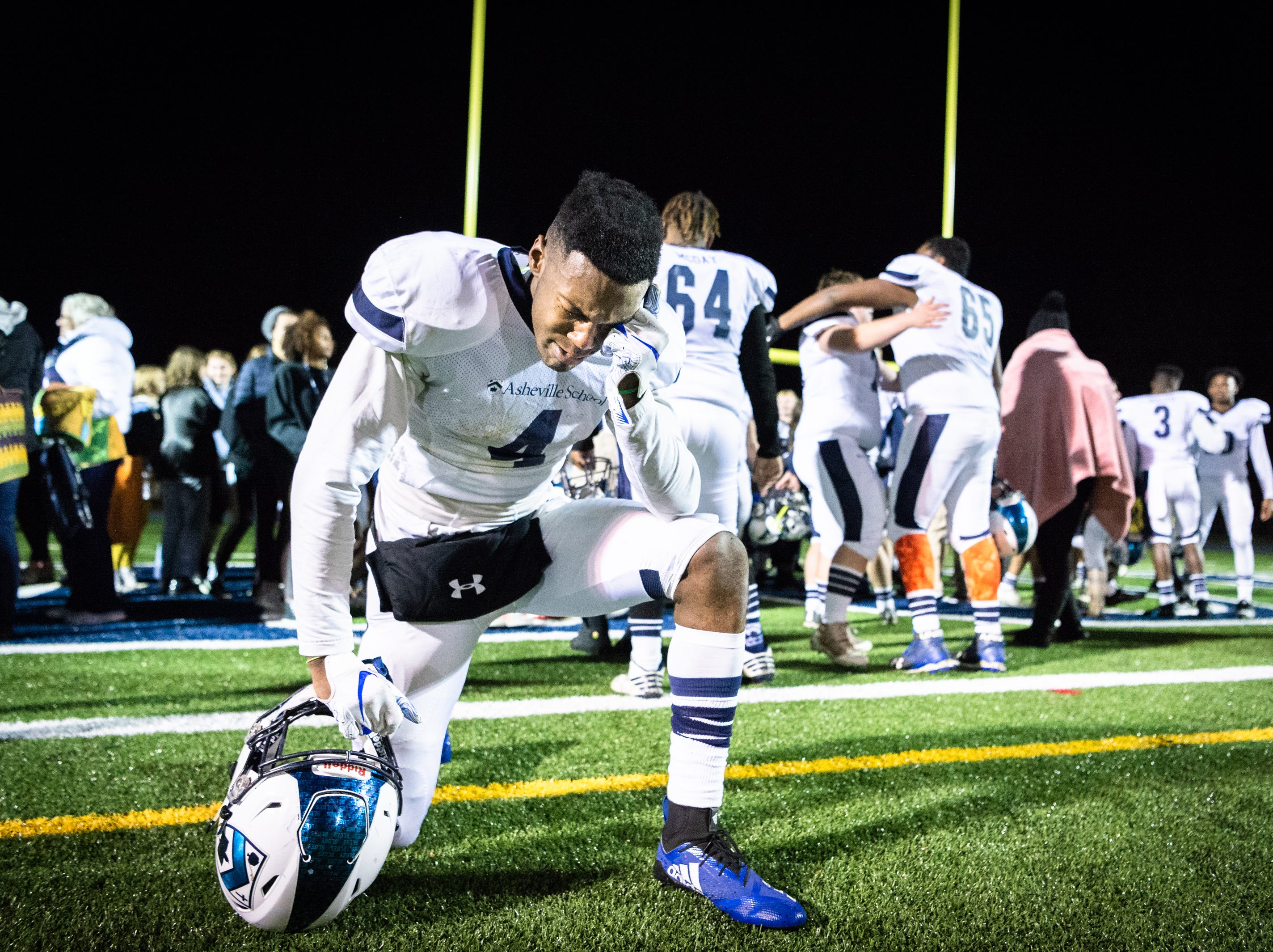 Asheville School's Christopher Hemphill takes a moment by himself, crying after their defeating Southlake Christian 33-28 in their Friday night second round semifinal game Nov. 9, 2018, advancing them to the NCISAA Division III state championship game.