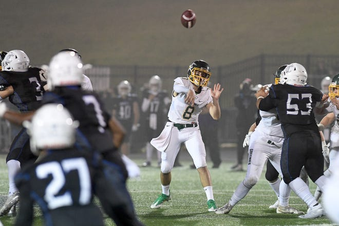 Christ School quarterback Navy Shuler throws a pass during the NCISAA Division I State Championship game at Charlotte Christian School on Nov. 9, 2018. The Greenies fell to the Knights 43-14.