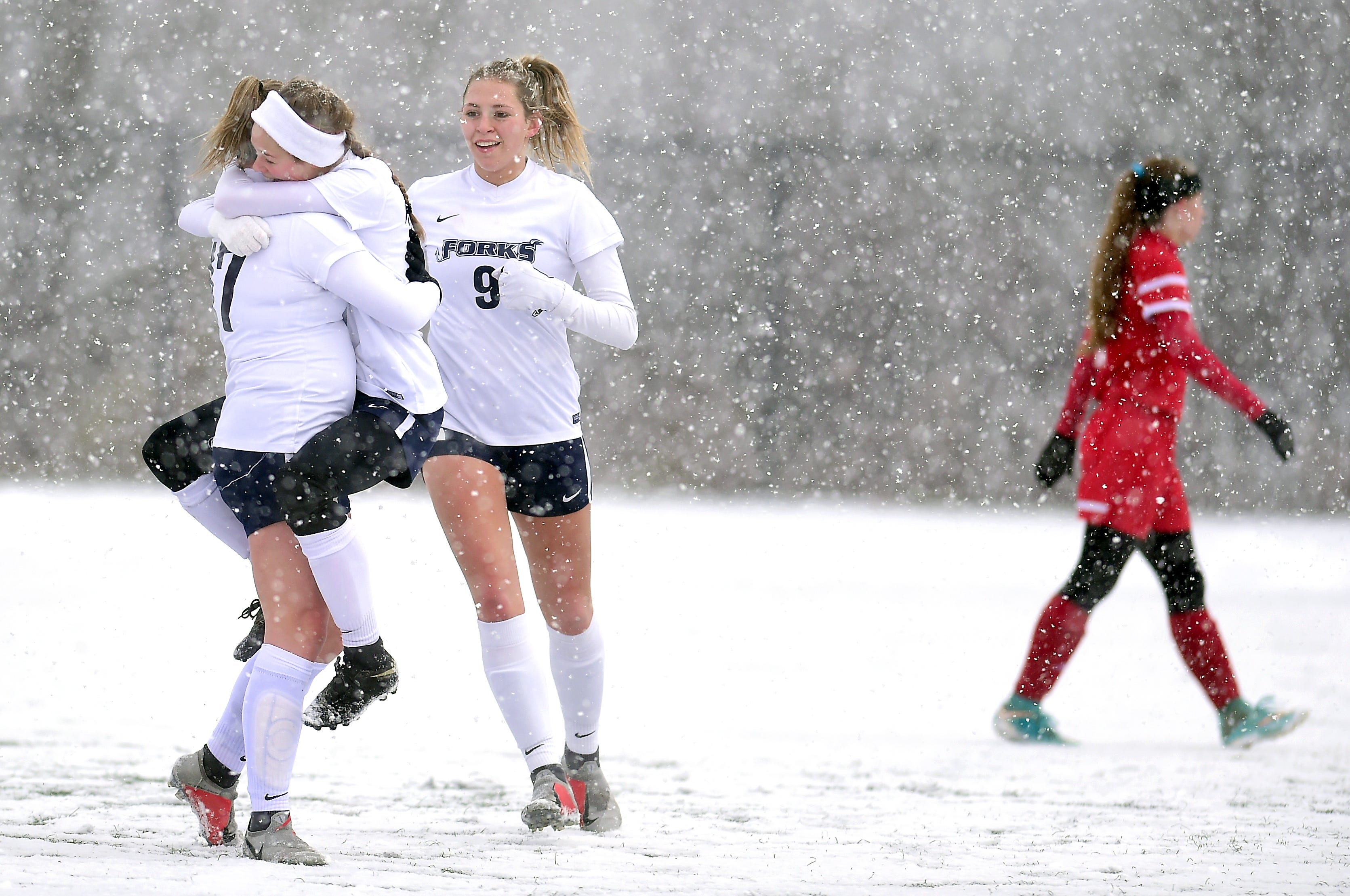 Chenango Forks teammates Aubrey Bough, left, Cassidy Walsh, middle, and Lauren Ashman celebrate a goal during the first half of Chenango Forks' 3-0 victory over Wheatley in the Class B semifinals at Cortland High School on Saturday.