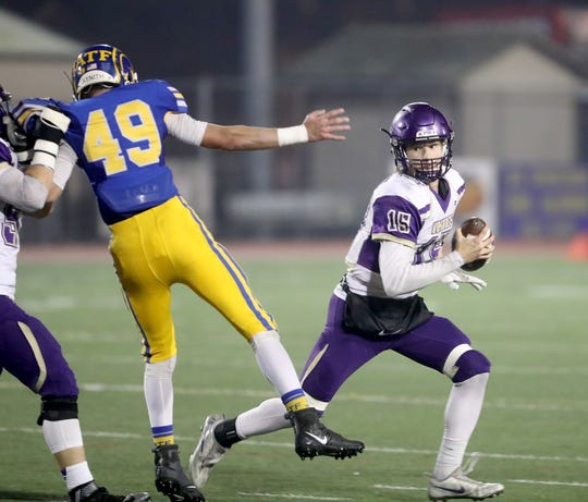 North Kitsap quarterback Andrew Blackmore looks for running room against Fife.