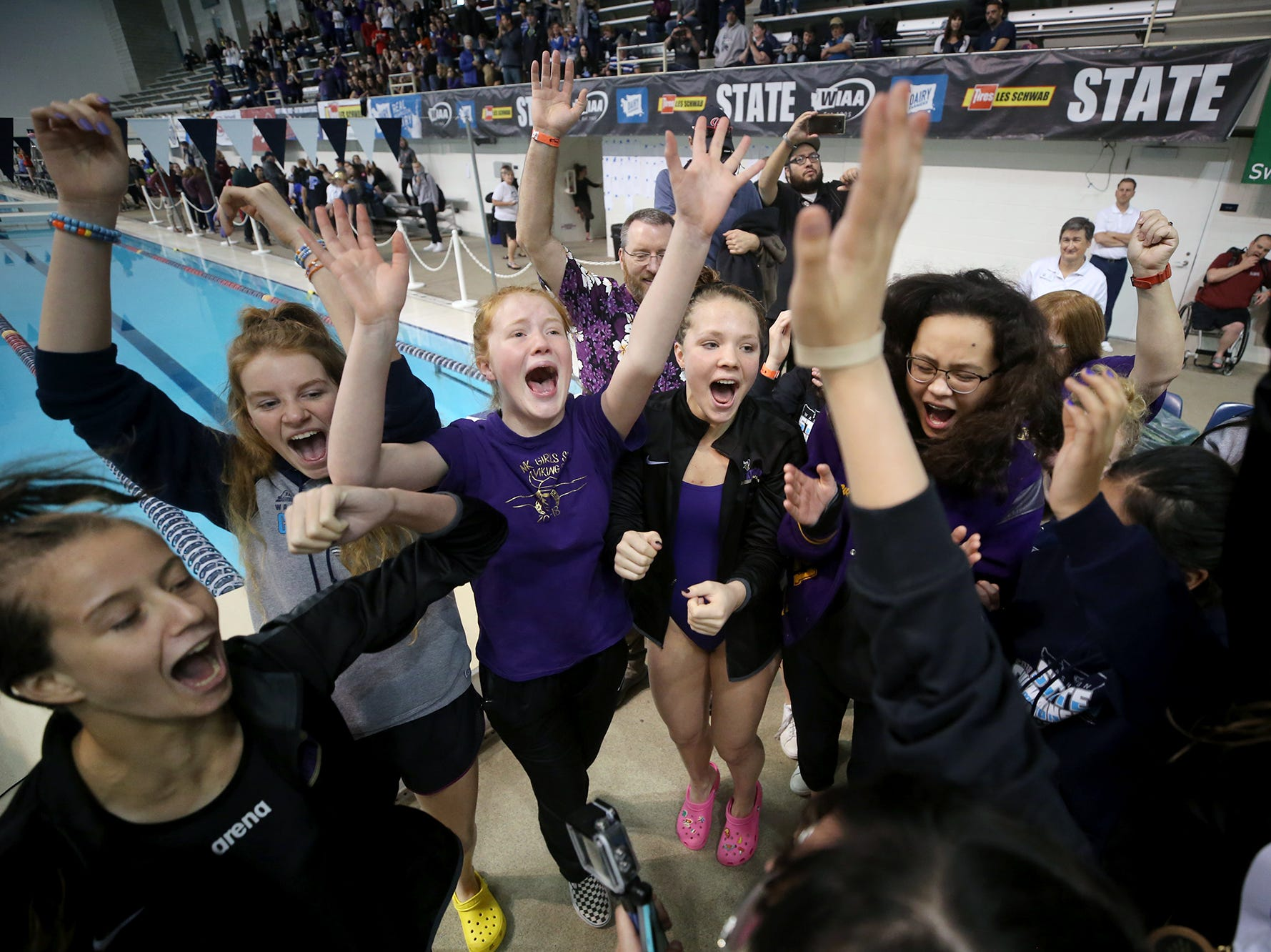 The North Kitsap Girls swim team won the team title at the 2018 2A Girls State Swim & Diving Championships on Saturday, November, 10, 2018 at the King County Aquatics Center, in Federal Way.  North Kitsap swimmers cheer after winning the team title.