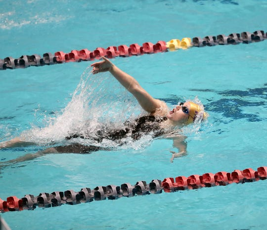 North Kitsap's Isabel Hendryx won the Class 2A 100-yard backstroke title Saturday at the King County Aquatic Center in Federal Way.