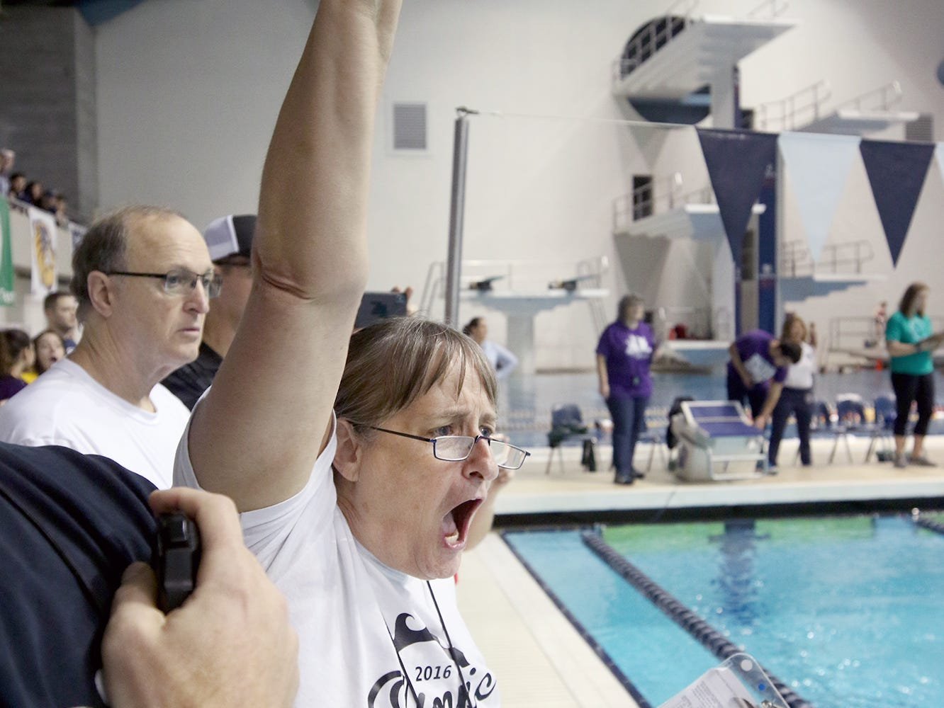 The North Kitsap Girls swim team won the team title at the 2018 2A Girls State Swim & Diving Championships on Saturday, November, 10, 2018 at the King County Aquatics Center, in Federal Way. Olympic assistant coach Patti Matthew cheers on Olympic swimmer Chloe Partsch in the girls 200 yard IM.