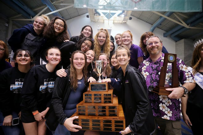 North Kitsap captured the Class 2A team title at the state swim and dive championships on Saturday at the King County Aquatic Center in Federal Way. Coach Greg Braun (right) earned 2A coach of the meet for the second straight year.
