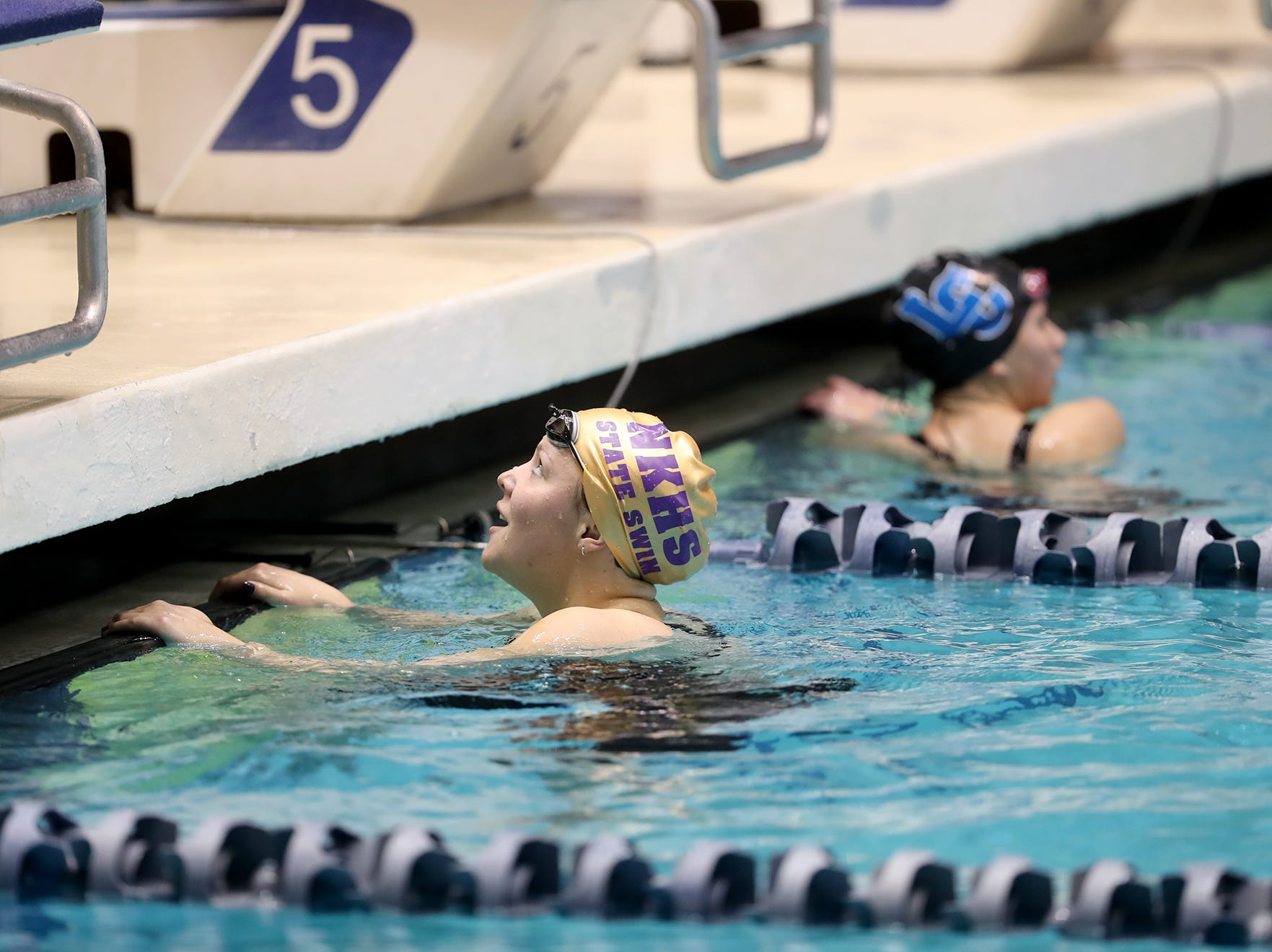 The North Kitsap Girls swim team won the team title at the 2018 2A Girls State Swim & Diving Championships on Saturday, November, 10 , 2018 at the King County Aquatics Center, in Federal Way. North swimmer Eleanor Beers looks up and smiles after winning the 50 yard freestyle.