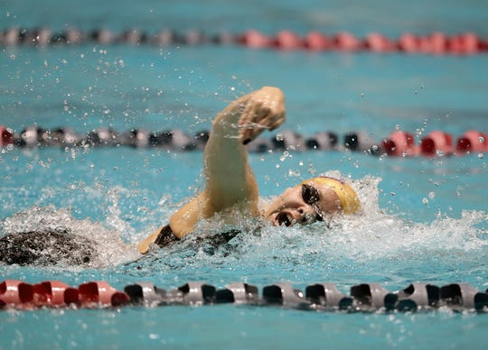 North Kitsap swimmer Eleanor Beers won the 50 and 100 freestyle races for the third consecutive year Saturday at the 2A state swim championships.