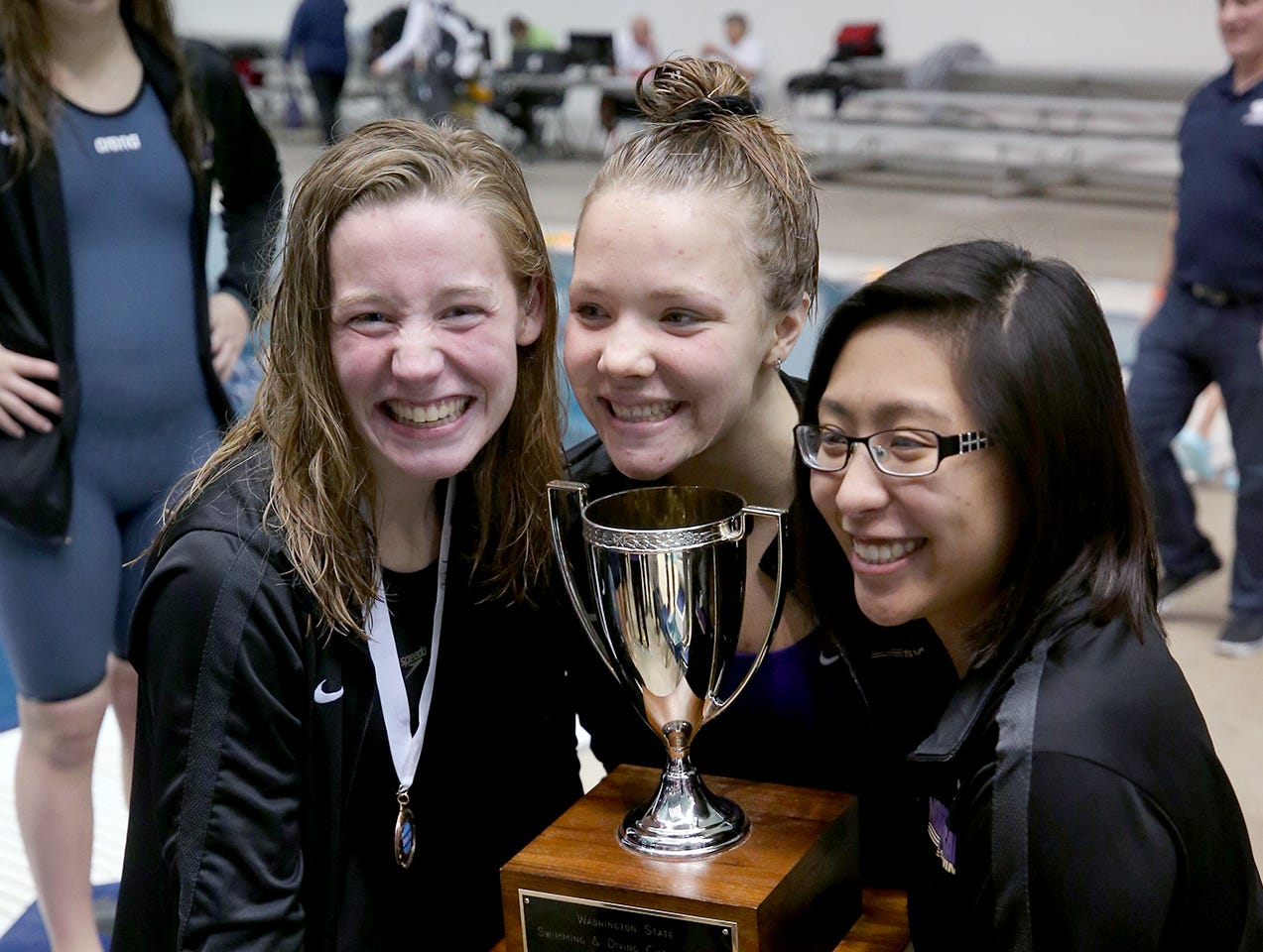 The North Kitsap Girls swim team won the team title at the 2018 2A Girls State Swim & Diving Championships on Saturday, November, 10, 2018 at the King County Aquatics Center, in Federal Way.  North Kitsap swimmers pose with the swimming title trophy.