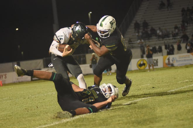Viera rising senior defensive tackle Jamari Lyons (50) makes a tackle in a playoff game last fall.. Lyons is rated a four-star recruit by 247Sports.