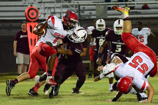 Mike Henderson was able to stop Red Devils quarterback Tyrek Dunlap Friday night as Astronaut defeated Avon Park in the opening round of high school football playoffs.