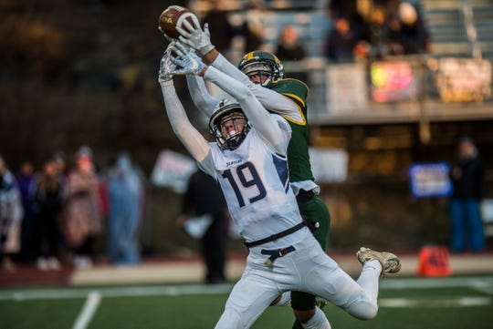 Burr and Burton's #12 John Morgantini intercepts a pass intended for Fair Haven's #19 Brett Huntley during the Vermont Div. 2 high school football championship in Rutland on Saturday, Nov. 10, 2018. Burr and Burton won, 63-14.