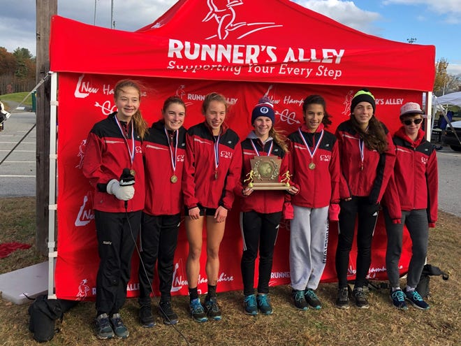 The CVU girls XC team poses with the New England trophy on Saturday. It's the fifth time the Redhawks have won the regional crown, all since 2003.