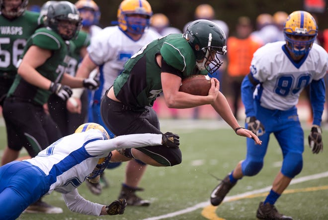 Woodstock's Caden White shakes off a tackle during the Division III high school football championship game at Rutland High School on Saturday, Nov. 10.