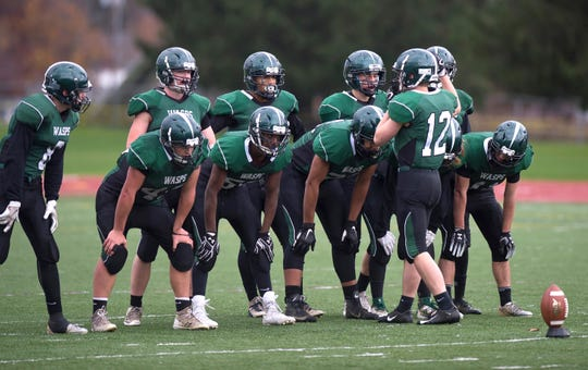 Woodstock's Jed Astbury (12) readies his team for a kickoff during the Division III high school football championship game at Rutland High School on Saturday, Nov. 10.