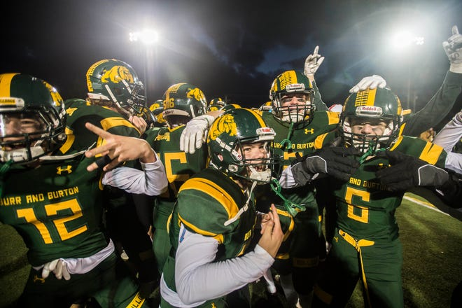 Burr and Burton Academy football celebrates during the Vermont Div. 2 high school football championship against Fair Haven in Rutland on Saturday, Nov. 10, 2018. Burr and Burton won, 63-14.