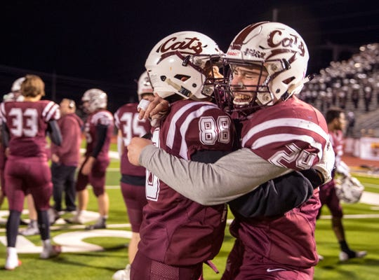 Calallen Wildcat's Gavin Vasquez (left) and Trace Taylor celebrate their win over Port Lavaca Calhoun in the 15-5A Division II game on Friday, November 9, 2018 at Phil Danaher Field at Wildcat Stadium. Calallen won the game 23-20 to win the district championship.