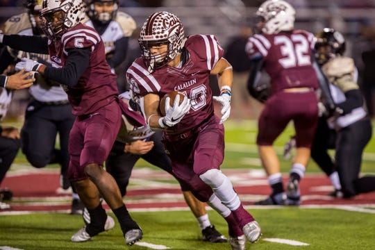 Calallen Wildcat's AJ Brown carries the ball in the fourth quarter of the 15-5A Division II game against Port Lavaca Calhoun on Friday, November 9, 2018 at Phil Danaher Field at Wildcat Stadium. Calallen won the game 23-20 to win the district championship.