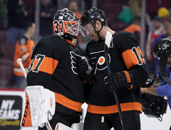 Goalie Brian Elliott made 33 saves and Sean Couturier had two goals and an assist in the Flyers' 4-0 win over the Chicago Blackhawks Saturday.