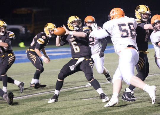 Paint Valley quarterback Bryce Newland looks to throw in a 40-6 playoff loss to Shadyside in a regional semifinal.