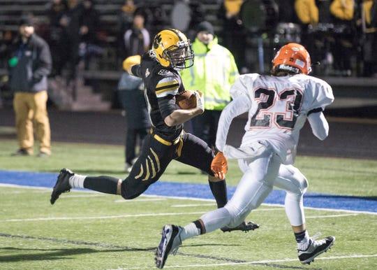 Junior Iann Cockerell runs a 60-yard reception to get Paint Valley near the goal line against Shadyside Friday night in Zanesville, Ohio.
